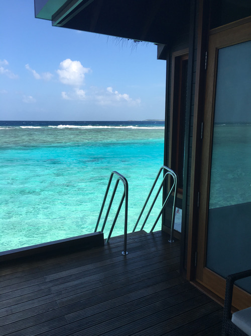 maldives hotel sheraton island ocean sea turquoise water hut room summer sun tropical