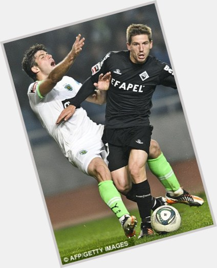 Adrien Silva light brown hair & hairstyles Athletic body,