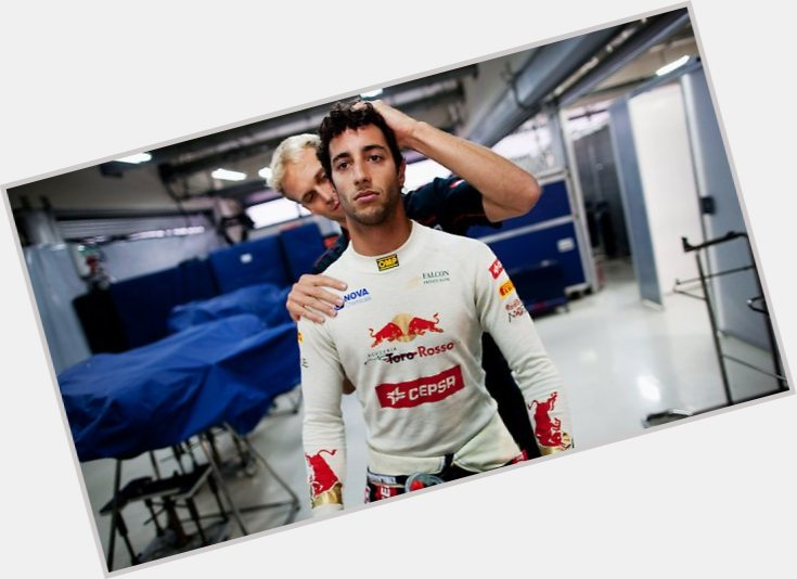 Daniel Ricciardo dark brown hair & hairstyles Athletic body,