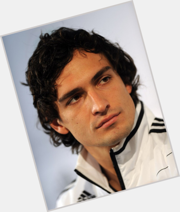 Mats Hummels dark brown hair & hairstyles Athletic body,