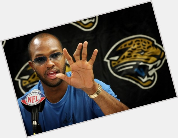 Torry Holt dark brown hair & hairstyles Athletic body,